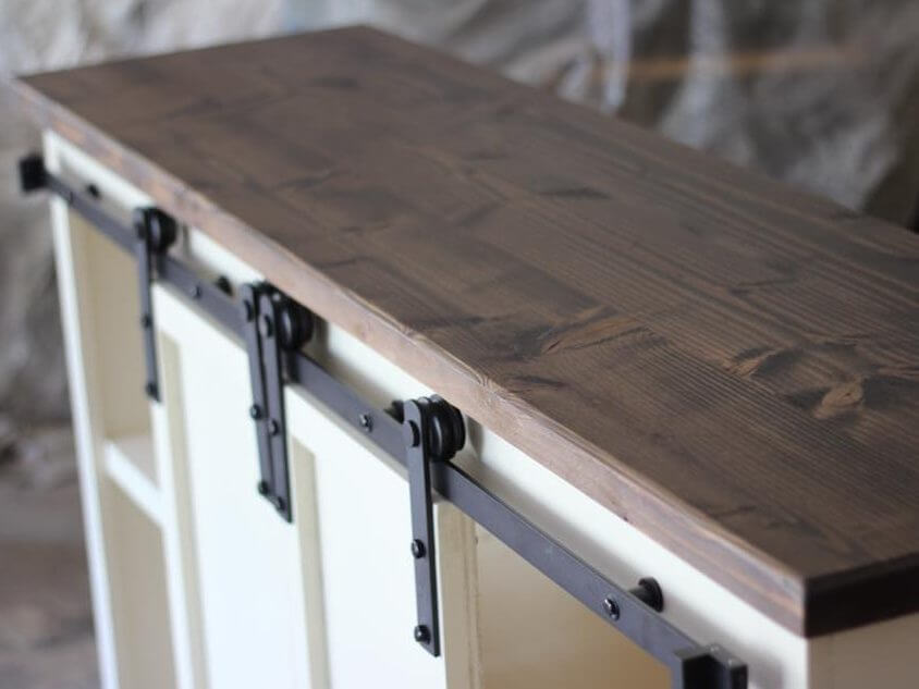 Walnut stained top on sliding barn door console