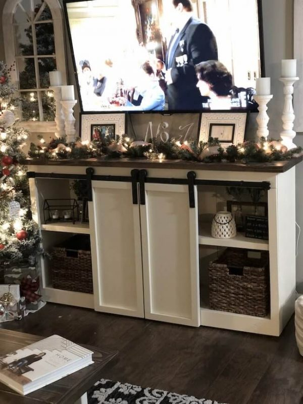 Double door sliding barn door console decorated for Christmas time