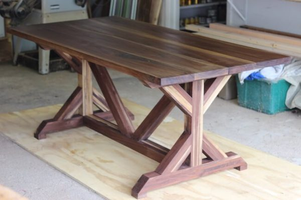 Custom made modern style walnut trestle dining table