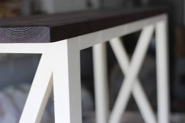 Close up on douglas fir console table stained dark walnut with white painted base