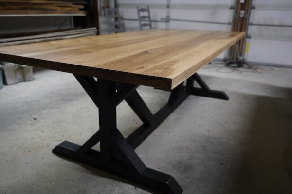 Hickory dining table with wooden pedestal base, double trestle style