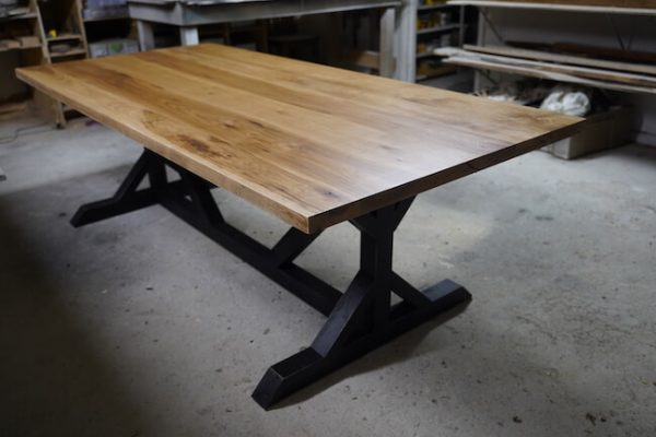 Light brown top hickory dining table with black legs