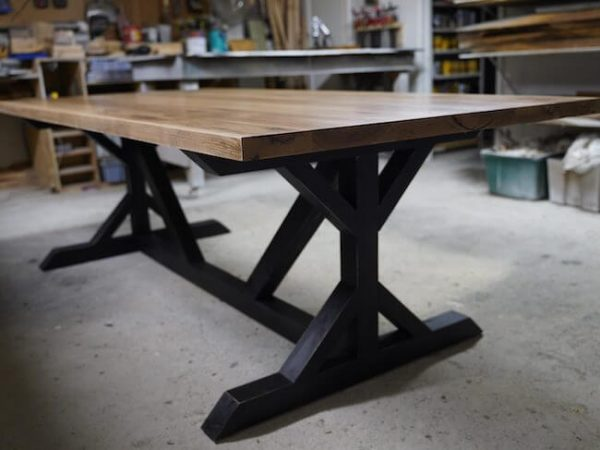 Hickory Trestle pedestal table custom made with a distressed black base