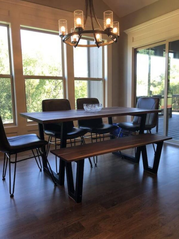 Modern walnut live edge custom made dining table and bench with 4 modern leather chairs and hanging chandelier