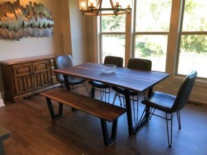 Custom made live edge walnut dining table and bench with steel tube legs and 4 modern style leather chairs to complete the dining set