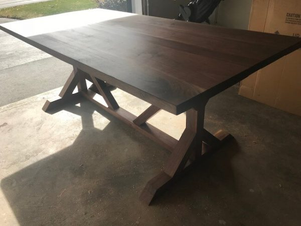 Custom made Trestle pedestal dining table built out of all walnut