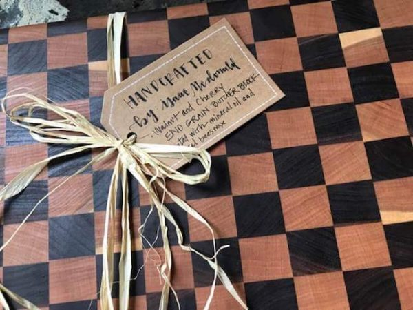 Walnut and cherry end grain cutting board with rustic bow and hand written note