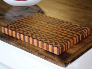 End grain butcher block checkered cutting board made of walnut and cherry