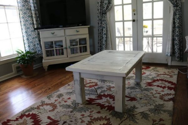 4 legged white coffee table in french country decor