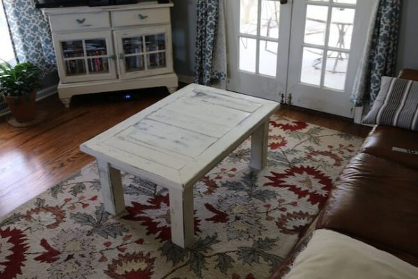 Custom made 4 legs coffee table, distressed in an antique white paint in a rustic style