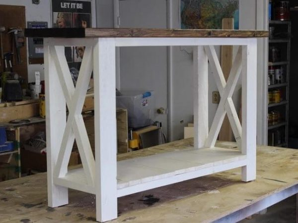White rustic X console table with dark walnut stained seamless top and one shelf