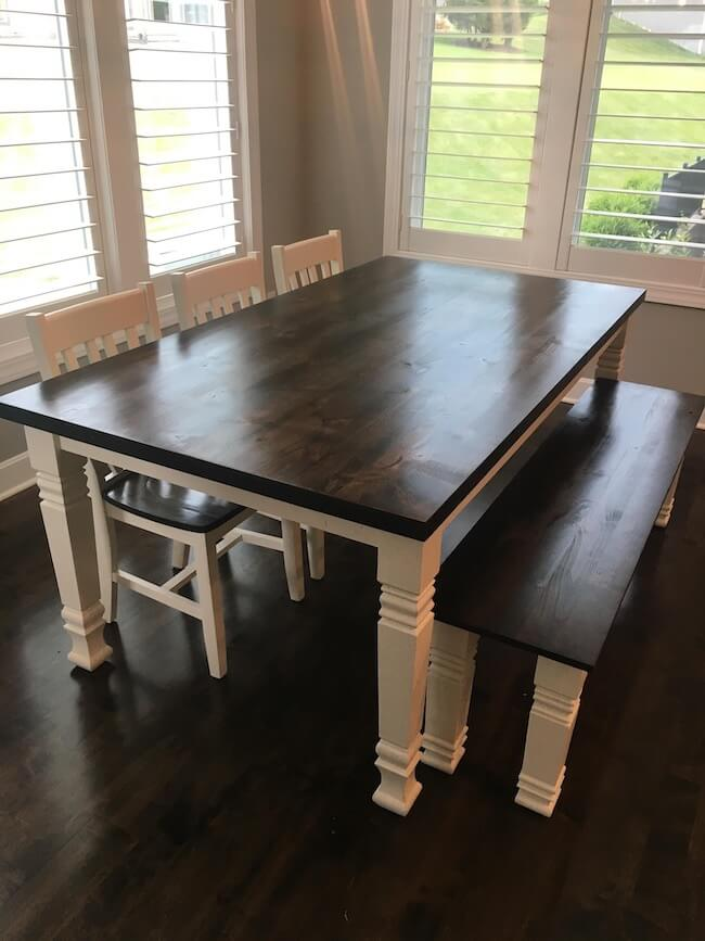 Alder dining table with accent legs, white base and stained dark walnut top