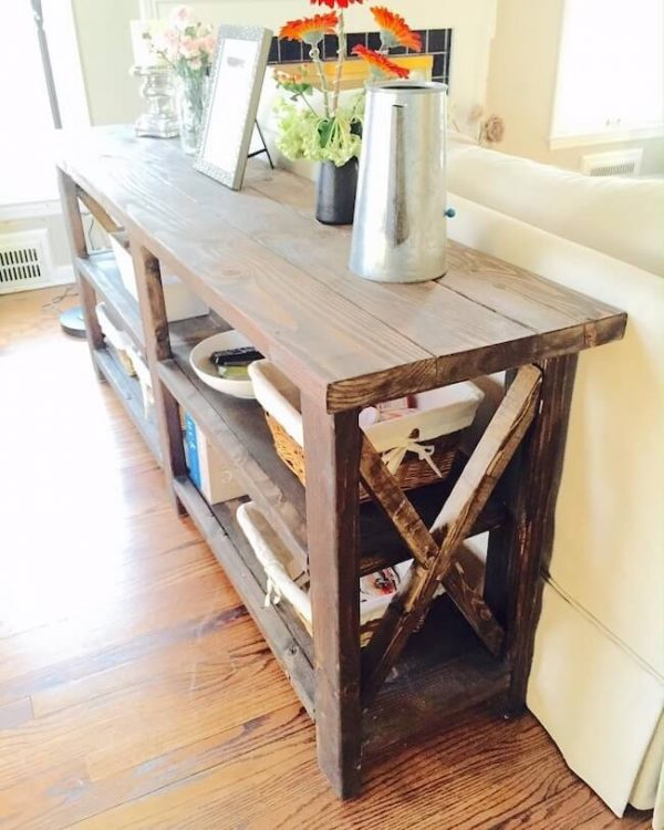 Rustic X console table with flowers and watering can, dark walnut stain
