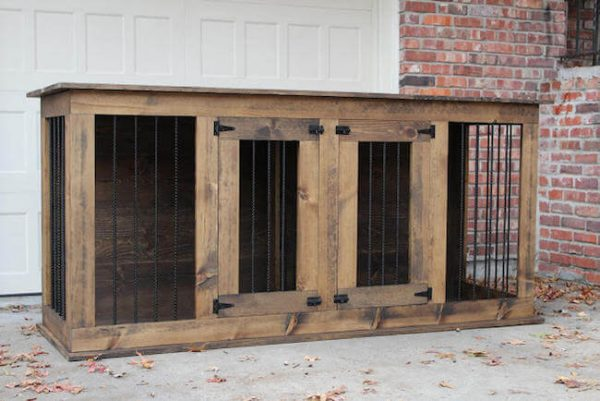 Two door dog kennel with brown stain dark walnut with black hardware