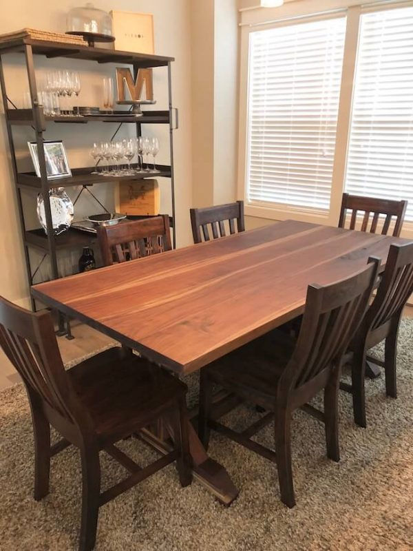 Custom made Trestle pedestal dining table built out of all walnut, chairs stained with a dark walnut stain to match the dining table