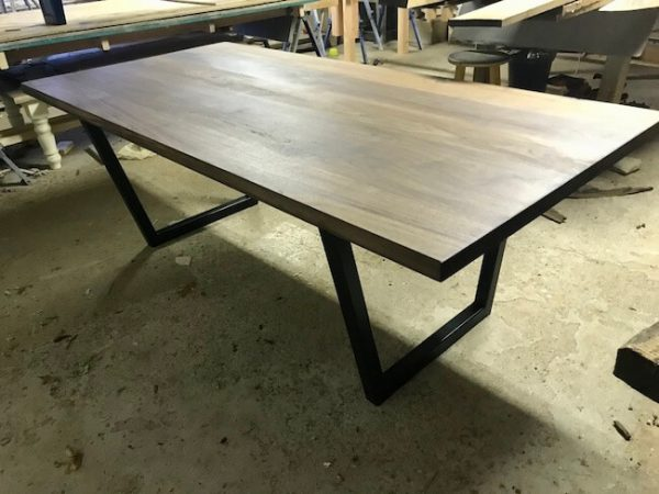 Farmhouse dining table, modern and clean lines with black painted base