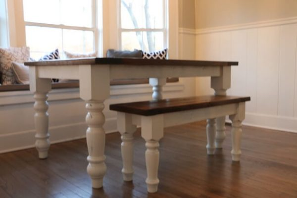 Medium sized farmhouse turned leg dining table custom made with painted white base and dark walnut top