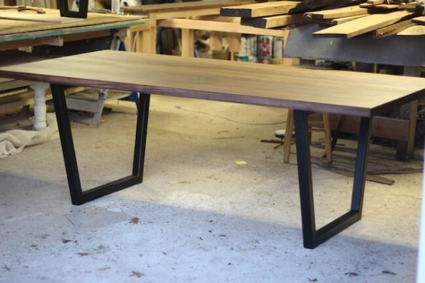 Walnut modern dining table with painted black steel tube legs custom made