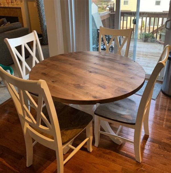 Painted white base and brown top round table with matching chairs in a dark walnut stain, rustic alder