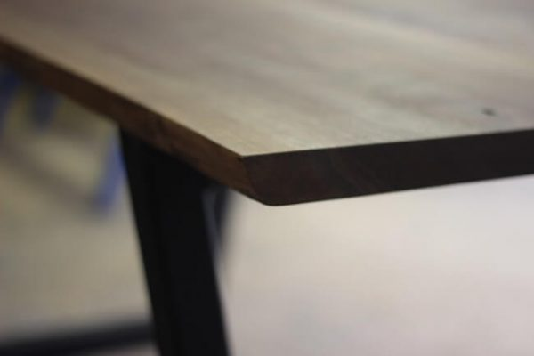 Modern walnut dining table and painted black steel legs detailed shot