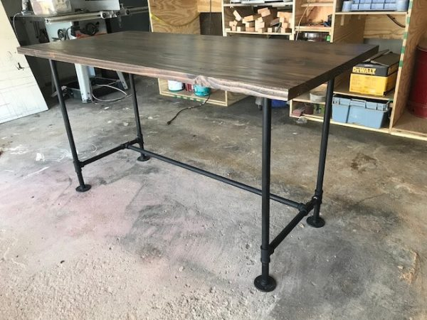 Custom made industrial style desk with steel pipe legs painted black and dark walnut stain