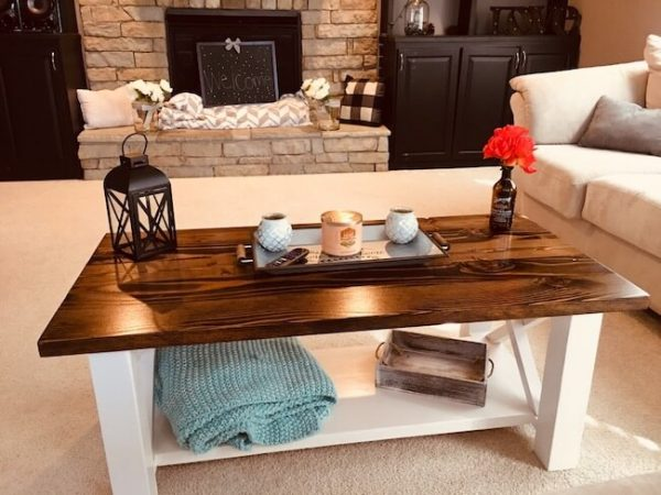 Custom made rustic X coffee table with a rustic alder top and antique white base