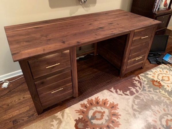 Custom made executive desk built from walnut with brass drawer pulls